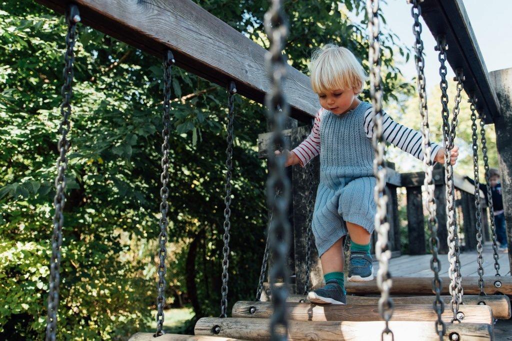 boy playing in london playground