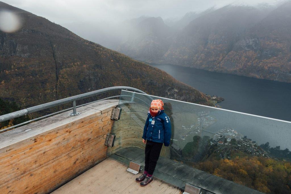 Girl standing on top of Stegastein viewpoint