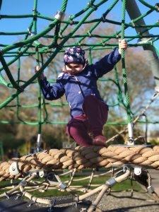 child climbing a frame