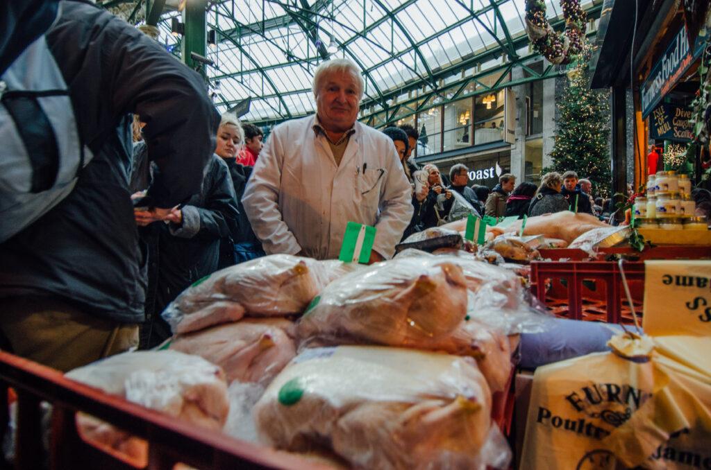 Stallholder selling chicken Borough Market