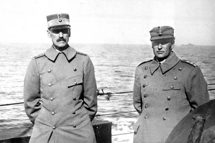 King Haakon and crown prince Olav at sea on their way to England
