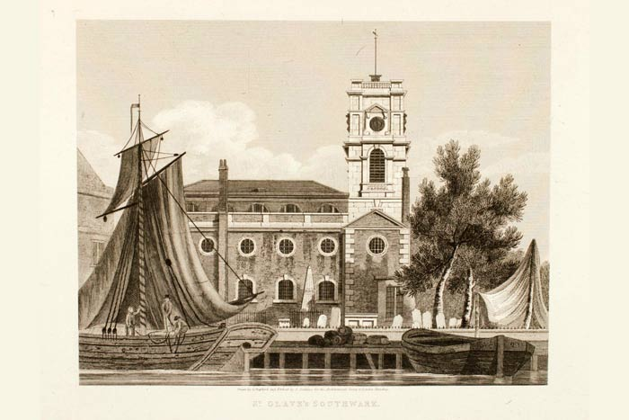St Olave church southwark with boats outside on the Thames