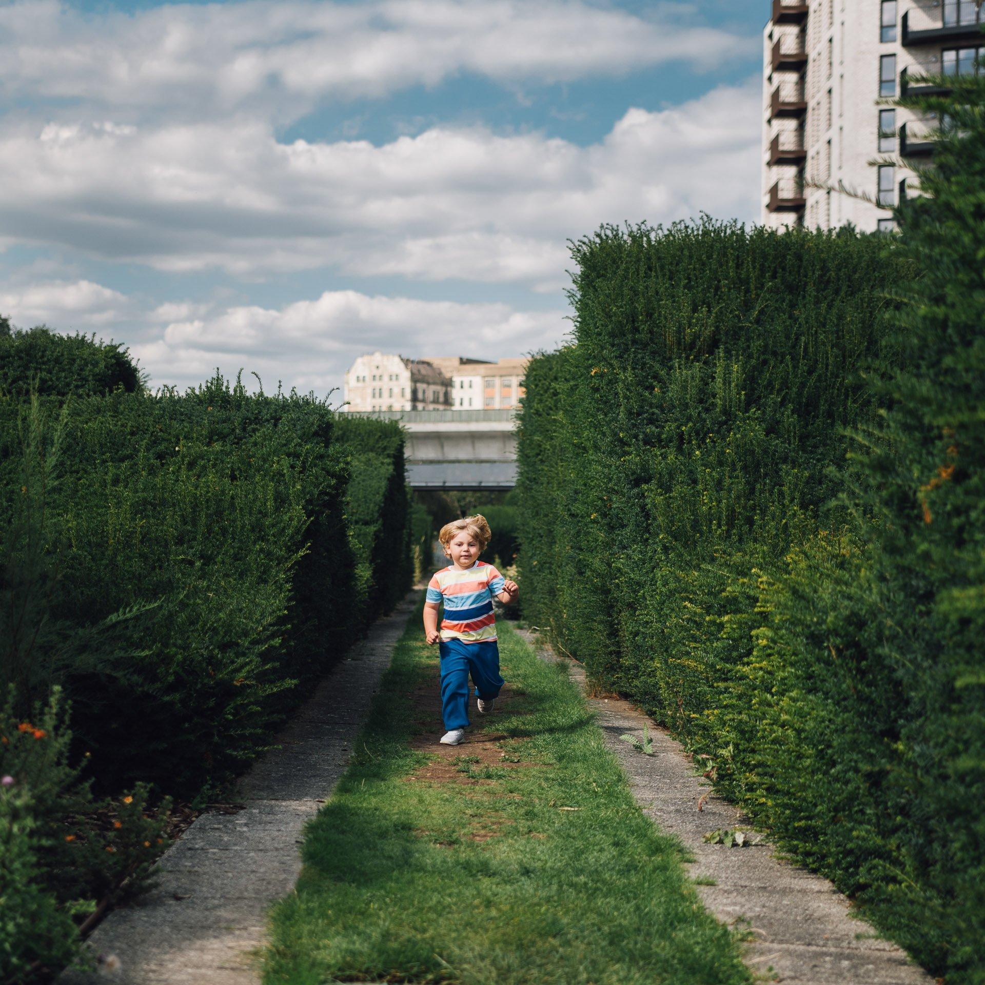 boy running in a park